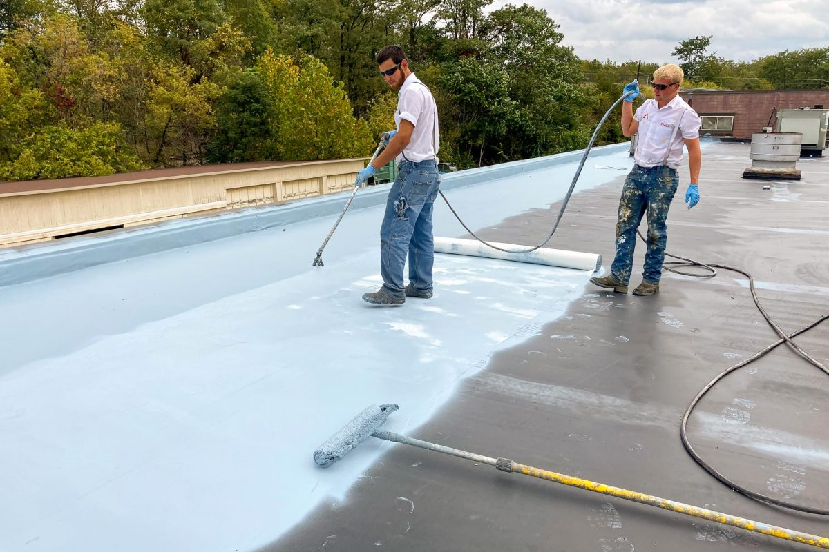 applying fabric-reinforced commercial roofing