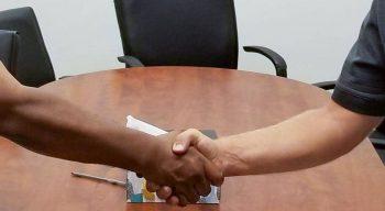 Men shaking hands - we